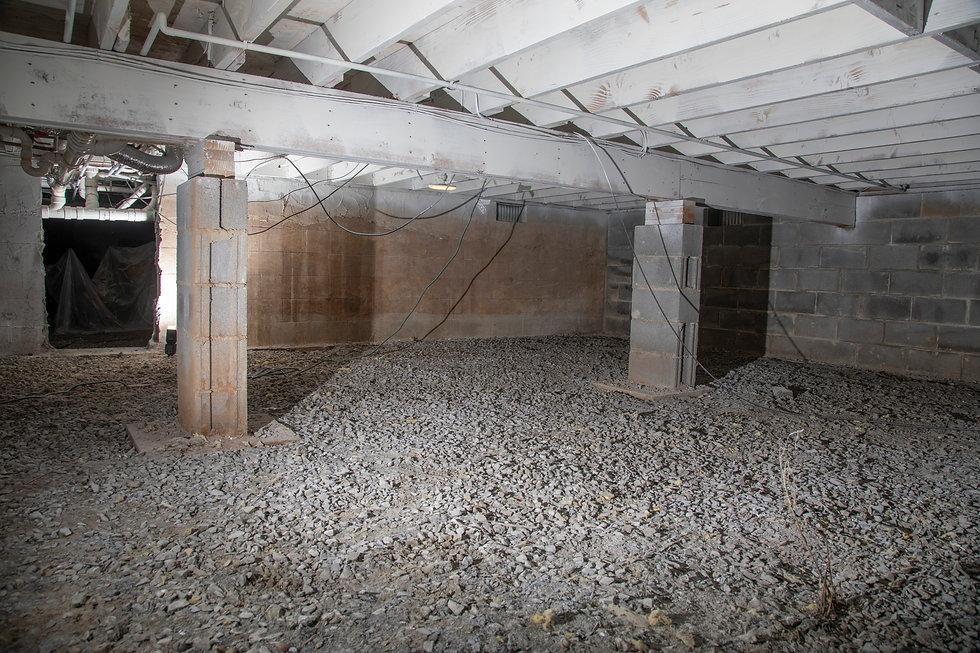 basement crawl space sans insulation.jpg