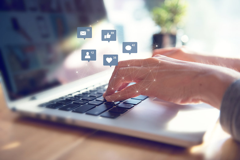 Businesswoman hands using laptop with icon social media and social network, Marketing conc