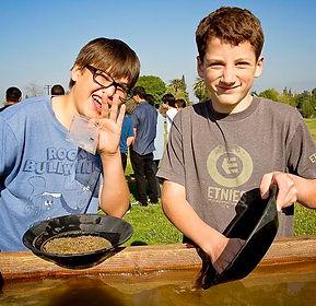 Two kids gold-panning