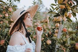 enjoying a freshly picked heirloom apple