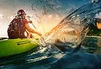 Kayaker splashing water
