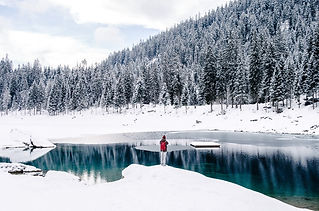person standing on a snowy lake in switzerland