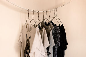 assorted-color%20clothes%20hanging%20on%20rod_edited.jpg