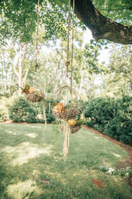 Hanging floral ceremony decor.jpg