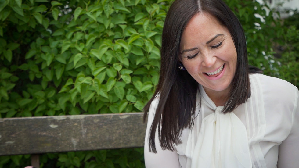Jenny McDonald sitting on a bench reading close up