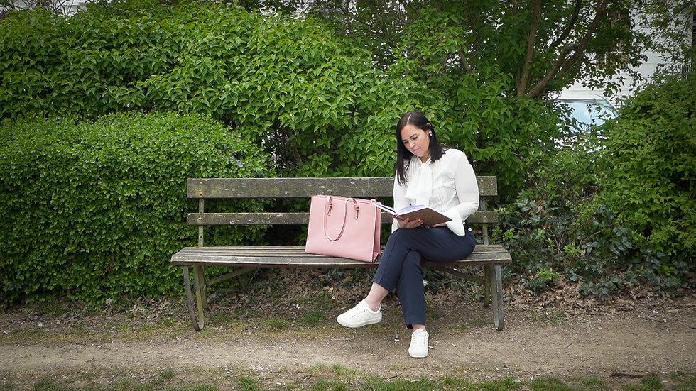 Jenny McDonald Sitting on a bench reading