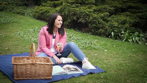 Jenny McDonald having a picnic drinking orange juice