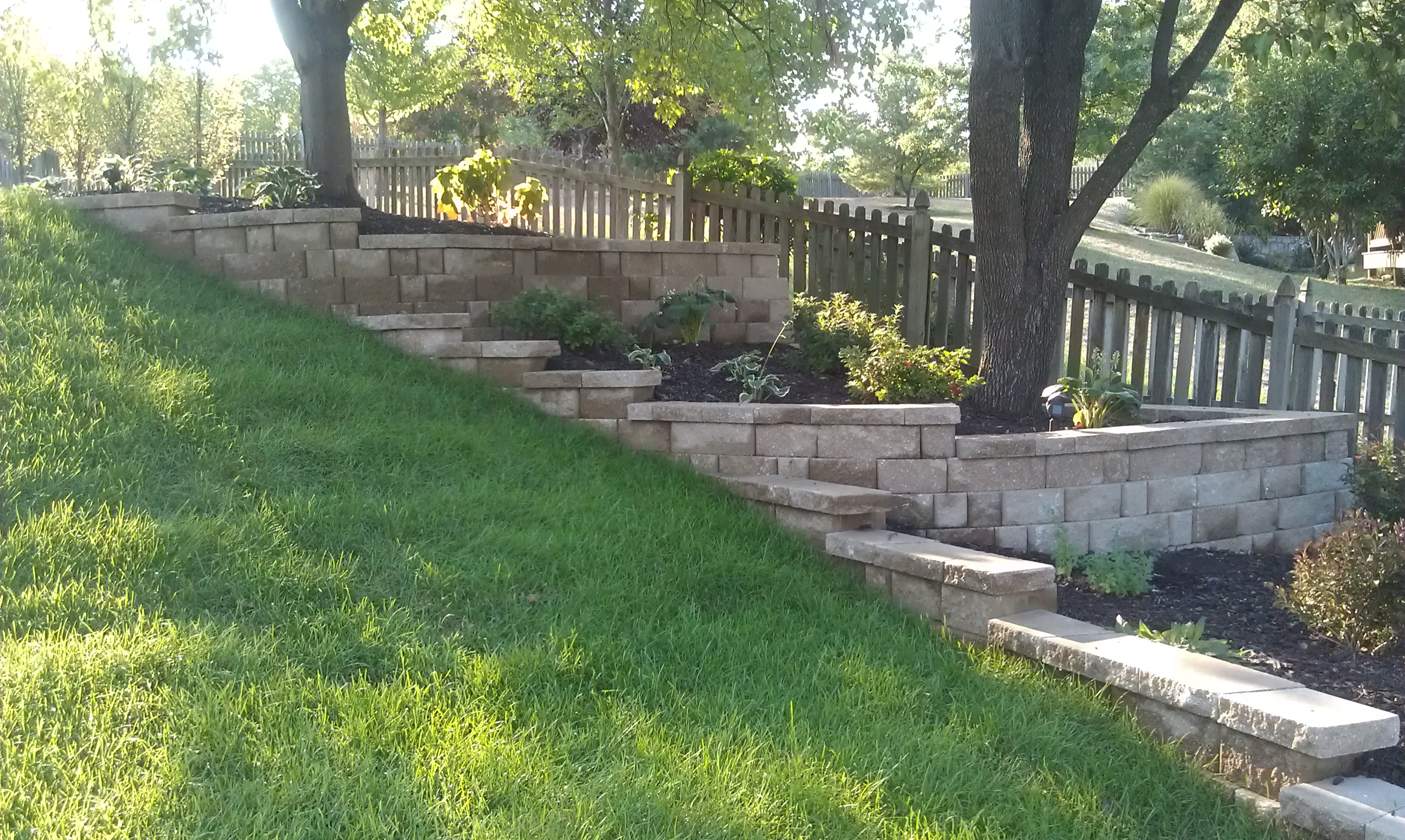#9 Retaining wall along fence