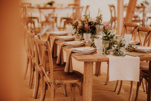 Wooden Cross back chairs and rustic tables for weddings