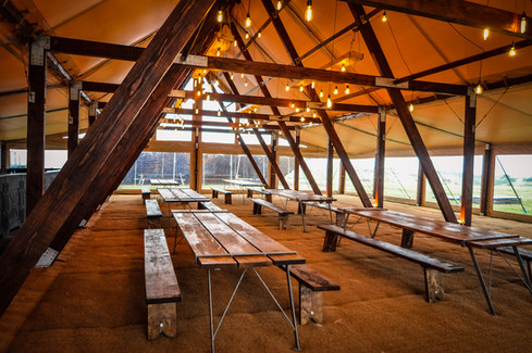 Rustic Tables and benches for hire by Husk Marquees