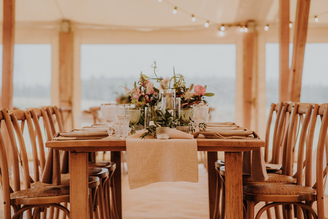 Natural table runner and festoon wedding lights