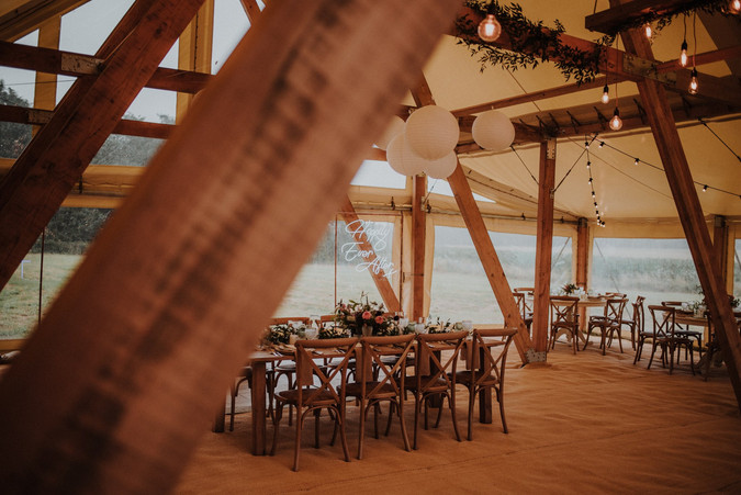 Timber beams and rustic tables