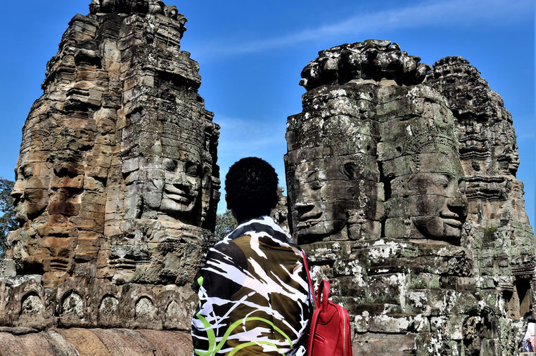 Bayon Temple face sulptures and girl in