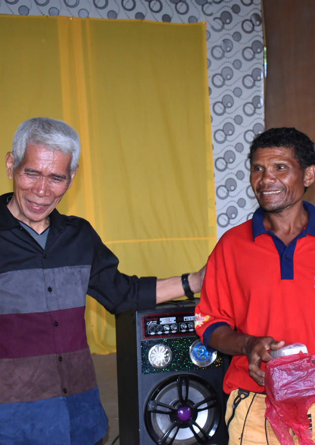 people in the mountain happy to receive audio bible
