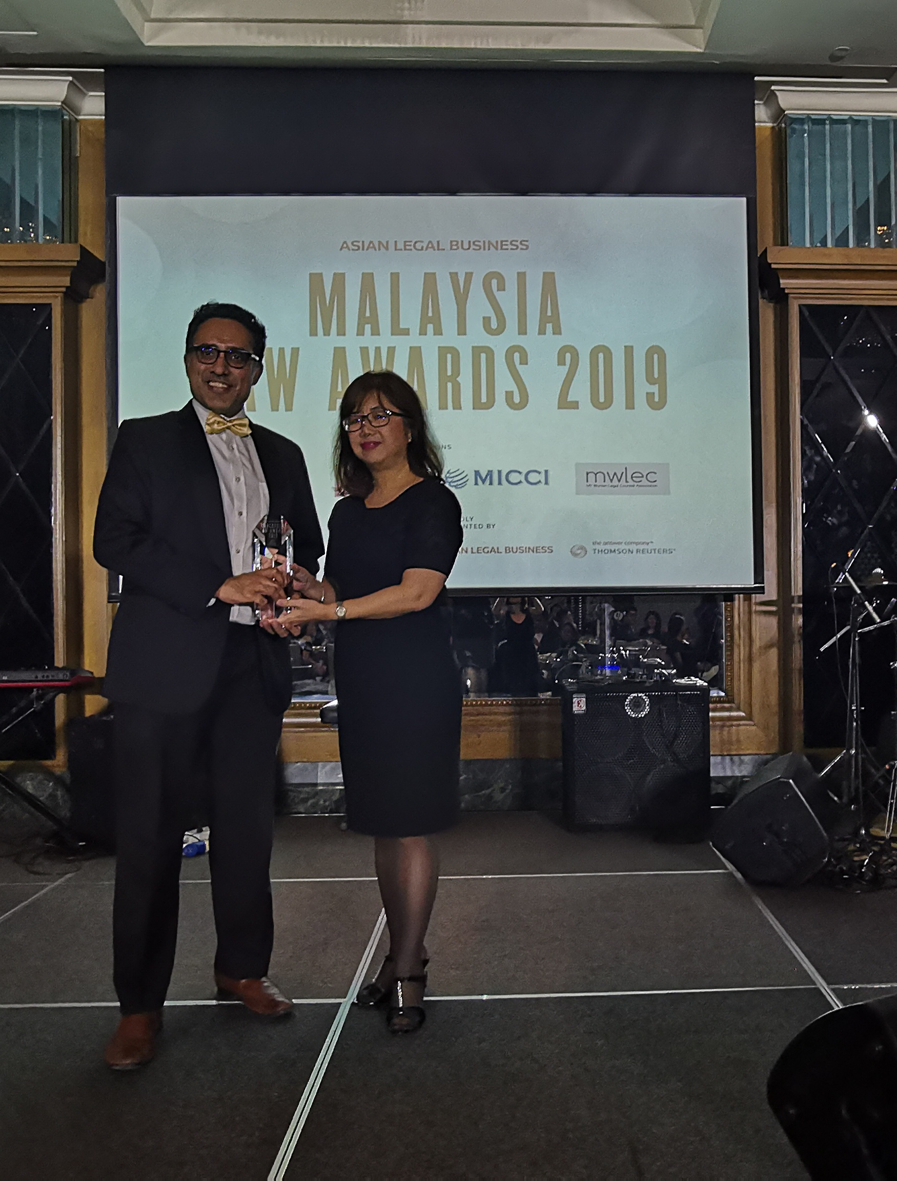 Suaran receiving the award on behalf of