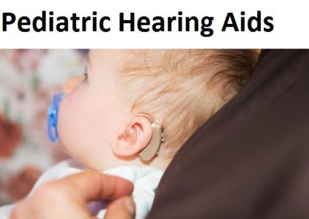 title: pediatric hearing aids. photo of the side view of a baby's head, the baby is sucking a pacifer and is wearing a hearing aid.