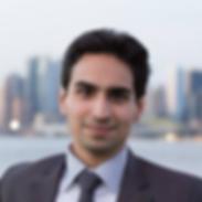 Headshot Mohamad FallahRad, brown suit jacket, salt/p, blue button-down shirt, brown tie