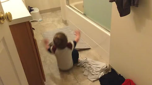 playing on the floor of the bathroom