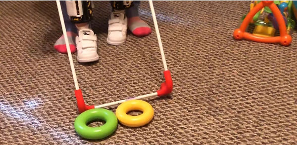 Belt cane frame locates toys on the floor