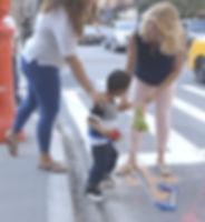 Four year old boy walking wearing belt cane