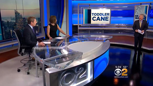 screen shot of CBS 2 news studio with the two anchors, Max Gomez and the title of the story Toddler Cane