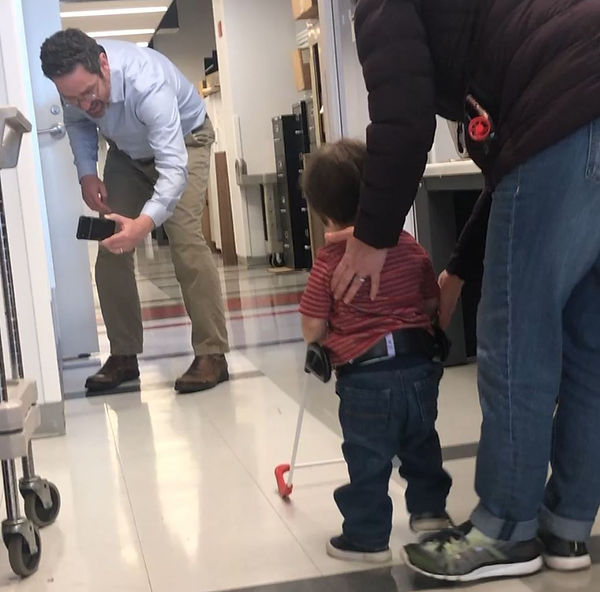 Dr. Bikson seen filming one year old wearing belt cane a CCNY