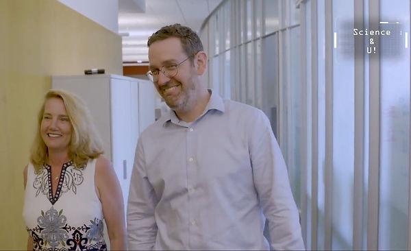 Professor Bikson and Grace Ambrose-Zaken walking down hallway for CUNY-TV shoot. Science & U