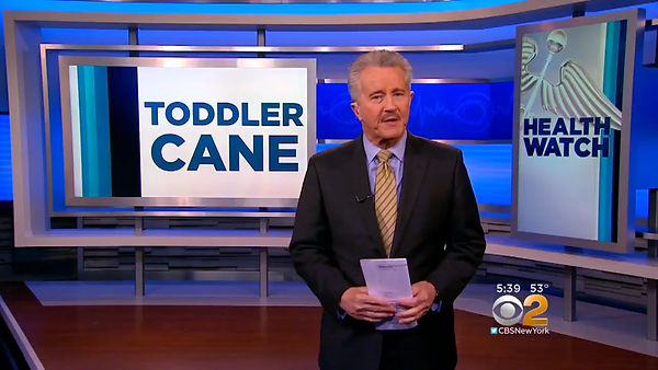 max gomez standing in news studio reporting in front of sign that reads toddler cane