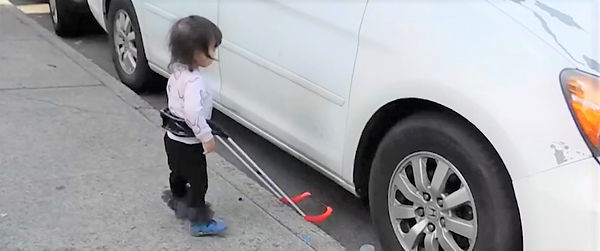 Charna two-year-old girl, blind wears belt cane finds curb drop off