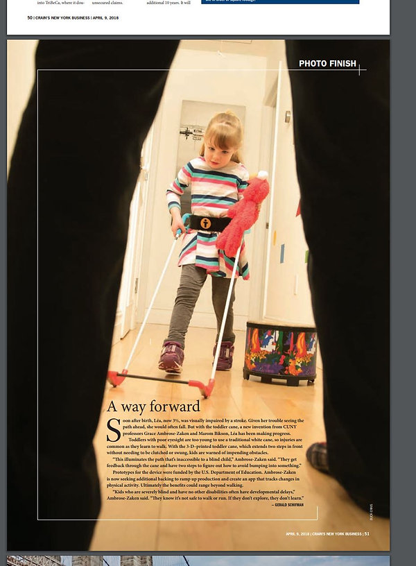 Back cover of Crain's New York magazine shows three-year-old girl with visual impairment wearing a belt cane, holding her doll, walking towards a pair of adult legs. Reads A way forward.