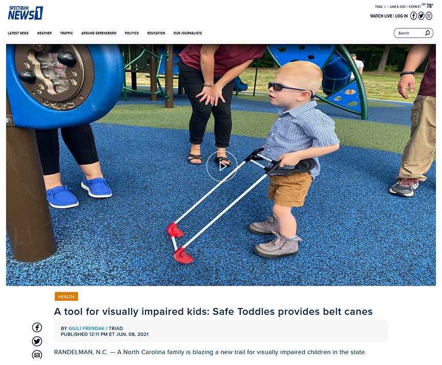 two year old with cortical visual impairment wears his pediatric belt cane at the playground on TV Spectrum 1 news story in North Carolina