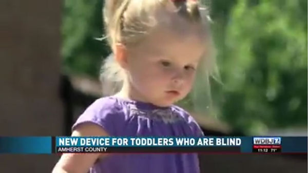 WDBJ 7 screen shot of the news story on belt canes title reads New Device for Toddlers Who are Blind