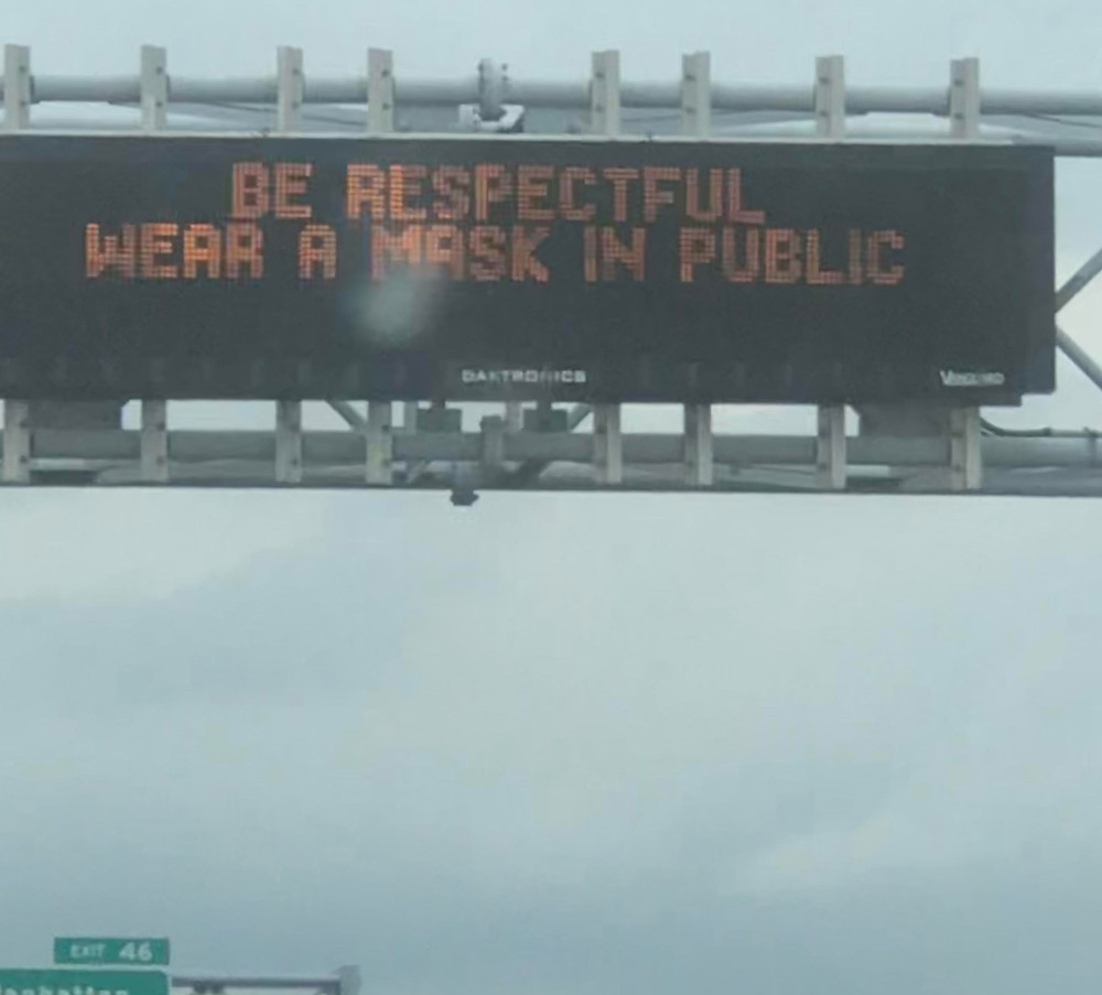 Road sign reads Be respectful wear a mask in public