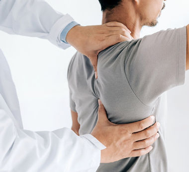 _photos_physiotherapist-doing-healing-treatment-on-mans-backback-pain-patient-picture-id11