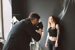 tattoo-master-taking-photos-on-camera-of