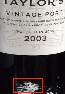 Splash of white paint on Taylor Vintage Port - the white paint should be facing up when cellared for best results