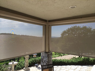 Exterior Roll Shades increase privacy and decrease UV rays