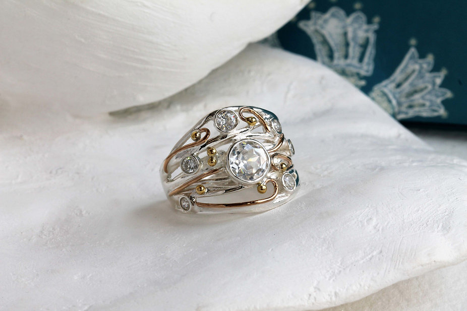 Isla Silver handmade sterling silver and gold detail ring featuring cubic zirconia gemstones