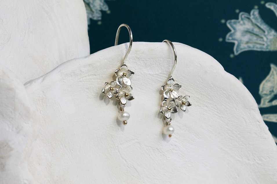 Isla Silver handmade silver hook earrings with three flowers and a white freshwater pearl