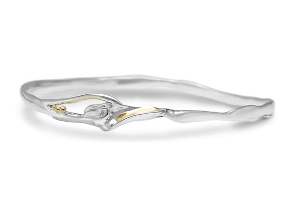 Abstract sterling silver bangle with brass ball detailing