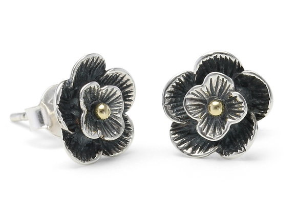 Oxidised silver flower stud earrings with gold centre