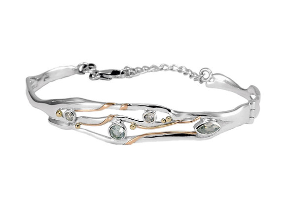 Hinged silver bangle with blue topaz and white cubic zirconia