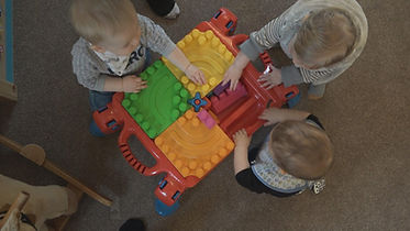 babies playing with Duplo