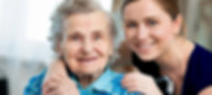 elderly lady with happy smiling care worker