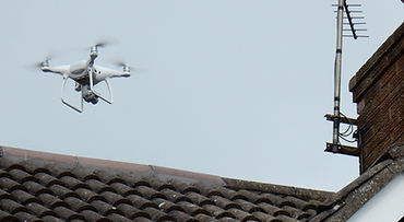 Drone flies above roof