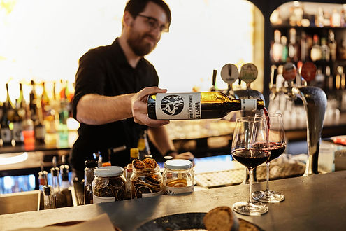 Bar Manager Pouring Red Wine