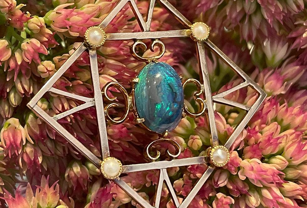 Pretty Edwardian black opal pendant