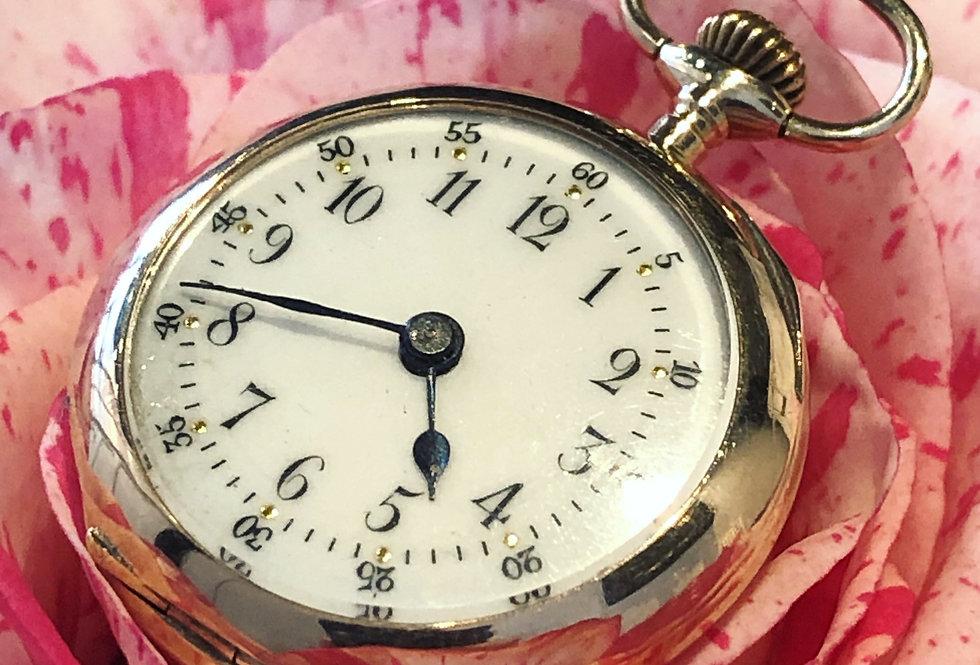 Rose gold miniature pendant watch