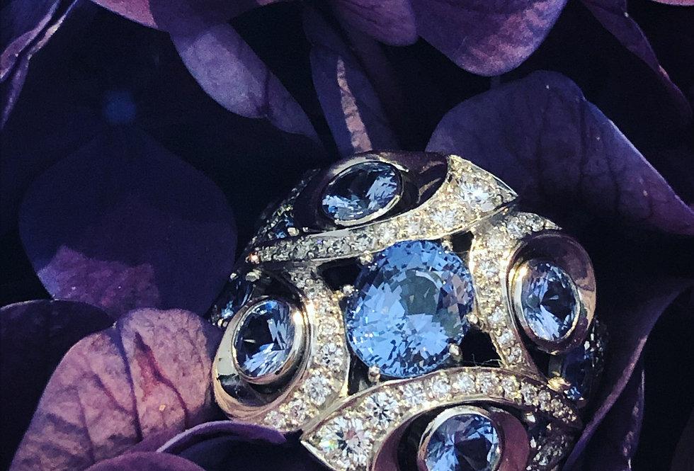 Platinum sapphire and diamond scroll ring