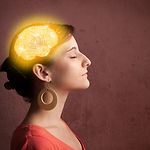 Young girl thinking with glowing brain i